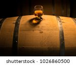 a glass of whiskey sits atop of ... | Shutterstock . vector #1026860500