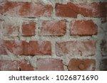 aged red bricks wall | Shutterstock . vector #1026871690