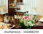 glasses of champagne  flowers | Shutterstock . vector #102688250