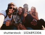 excited young friends taking... | Shutterstock . vector #1026892306