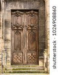ancient wooden entrance door to ... | Shutterstock . vector #1026908860