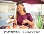 beautiful girl eating a tasty... | Shutterstock . vector #1026929434