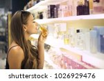 trying different perfumes   Shutterstock . vector #1026929476