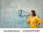 speaking loudly in the megaphone | Shutterstock . vector #1026929530