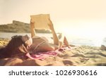reading at the beach | Shutterstock . vector #1026930616