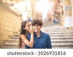 whispering a secret | Shutterstock . vector #1026931816