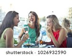 friends eating together | Shutterstock . vector #1026932590
