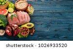 healthy food. raw meat  avocado ... | Shutterstock . vector #1026933520