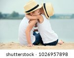 two brothers relaxing on the... | Shutterstock . vector #1026957898