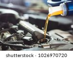 motor oil pouring to car engine. | Shutterstock . vector #1026970720