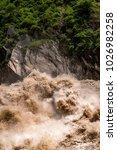 huge waves of muddy waters...   Shutterstock . vector #1026982258