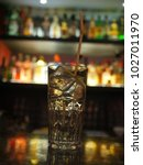 cocktail with ice  and straw in ... | Shutterstock . vector #1027011970