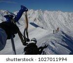 ski poles in the snow gloves... | Shutterstock . vector #1027011994