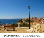 wooden bench and street lamp...   Shutterstock . vector #1027018738