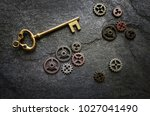 gold key and assorted metal... | Shutterstock . vector #1027041490