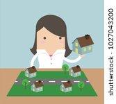 businesswoman plan to put her... | Shutterstock .eps vector #1027043200