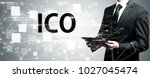 ico with man holding a tablet... | Shutterstock . vector #1027045474