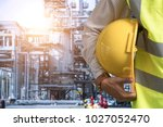 workers in the oil and gas... | Shutterstock . vector #1027052470