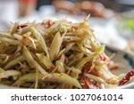 thai  papaya salad   Shutterstock . vector #1027061014