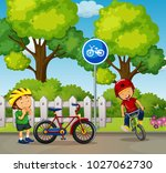 two boys riding bike in the... | Shutterstock .eps vector #1027062730