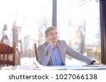 young professor speaking by... | Shutterstock . vector #1027066138