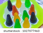colorful jelly in green plastic ... | Shutterstock . vector #1027077463