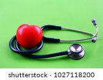 red heart shape and stethoscope ... | Shutterstock . vector #1027118200