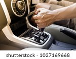 male hand using a car automatic ... | Shutterstock . vector #1027169668