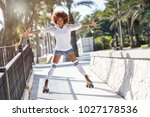 young black woman on roller... | Shutterstock . vector #1027178536