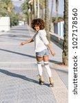 smiling black woman on roller... | Shutterstock . vector #1027178560