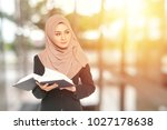 muslimah businesswoman with... | Shutterstock . vector #1027178638