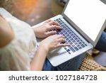 women typing keyboard laptop...   Shutterstock . vector #1027184728
