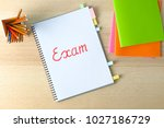 word exam written in notebook... | Shutterstock . vector #1027186729