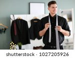 man in new outfit indoors.... | Shutterstock . vector #1027205926