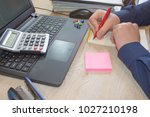 businessman using a calculator... | Shutterstock . vector #1027210198