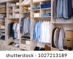 big wardrobe with male clothes... | Shutterstock . vector #1027213189