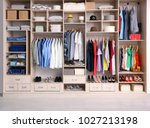 Small photo of Big wardrobe with different clothes for dressing room