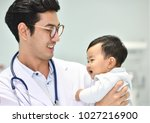 asian pediatrician is taking...   Shutterstock . vector #1027216900
