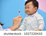doctor holding syringe with...   Shutterstock . vector #1027220410