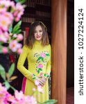 the young girl wear ao dai in... | Shutterstock . vector #1027224124