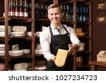 business owner with cheese in... | Shutterstock . vector #1027234723