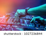 dj mixes the track in the... | Shutterstock . vector #1027236844