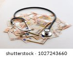 health care spending | Shutterstock . vector #1027243660