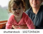 a young mother travels in... | Shutterstock . vector #1027245634