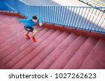 athletic man running on stairs... | Shutterstock . vector #1027262623