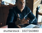 business man sitting at table... | Shutterstock . vector #1027263883