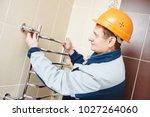 plumber service. worker... | Shutterstock . vector #1027264060