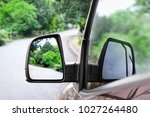 reflection of green trees near... | Shutterstock . vector #1027264480
