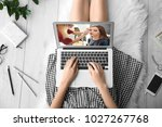 woman sitting on floor with... | Shutterstock . vector #1027267768