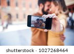 dating. loving couple taking a... | Shutterstock . vector #1027268464